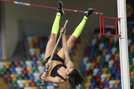 olympic game: ISTANBUL, TURKEY - FEBRUARY 25, 2016: Athlete Buse Arikazan pole vaulting in Athletics Istanbul Indoor Championships