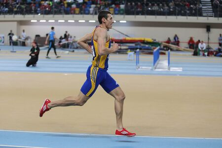 olympic game: ISTANBUL, TURKEY - FEBRUARY 27, 2016: Athlete Cristian Vorovenci running in Balkan Athletics Indoor Championships