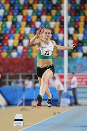 championships: ISTANBUL, TURKEY - FEBRUARY 27, 2016: Athlete Andriana Banova triple jumping in Balkan Athletics Indoor Championships