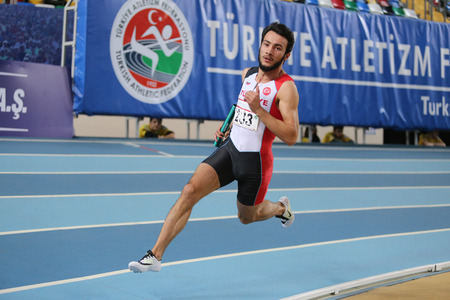 ISTANBUL, TURKEY - FEBRUARY 27, 2016: Athlete Batuhan Altintas running 4x400 metres in Balkan Athletics Indoor Championships