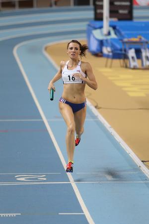 olympic game: ISTANBUL, TURKEY - FEBRUARY 25, 2016: Athlete Iveta Putalova running 4x400 metres in Athletics Istanbul Indoor Championships
