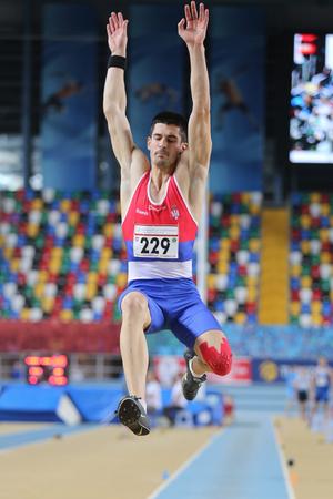 championships: ISTANBUL, TURKEY - FEBRUARY 27, 2016: Athlete Lazar Anic long jumping in Balkan Athletics Indoor Championships Editorial
