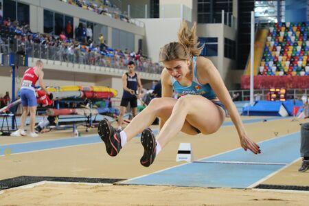 championships: ISTANBUL, TURKEY - FEBRUARY 27, 2016: Athlete Natalia Zdesenco long jumping in Balkan Athletics Indoor Championships