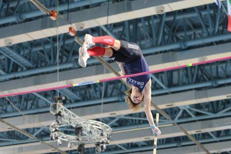 pole: ISTANBUL, TURKEY - FEBRUARY 25, 2016: Athlete Eduard Plotnikov pole vaulting in Athletics Istanbul Indoor Championships Editorial