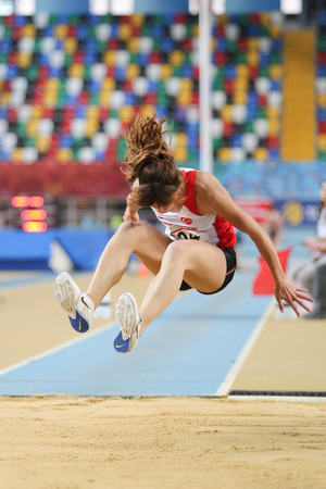 triple: ISTANBUL, TURKEY - FEBRUARY 27, 2016: Athlete Tugba Aydin triple jumping in Balkan Athletics Indoor Championships