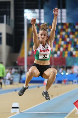 olympic game: ISTANBUL, TURKEY - FEBRUARY 27, 2016: Athlete Milena Mitkova long jumping in Balkan Athletics Indoor Championships Editorial