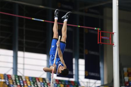 olympic game: ISTANBUL, TURKEY - FEBRUARY 25, 2016: Athlete Nilolaos Nerantzis pole vaulting in Athletics Istanbul Indoor Championships
