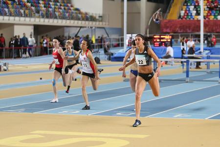 hurdles: ISTANBUL, TURKEY - FEBRUARY 25, 2016: Athletes running 60 metres hurdles in Athletics Istanbul Indoor Championships