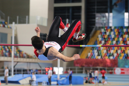 championships: ISTANBUL, TURKEY - FEBRUARY 27, 2016: Athlete Umit Tan high jumping in Balkan Athletics Indoor Championships