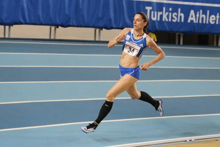 olympic game: ISTANBUL, TURKEY - FEBRUARY 27, 2016: Athlete Eleni Filandra running in Balkan Athletics Indoor Championships Editorial