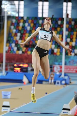olympic game: ISTANBUL, TURKEY - FEBRUARY 25, 2016: Athlete Chaido Alexouli long jumping in Athletics Istanbul Indoor Championships