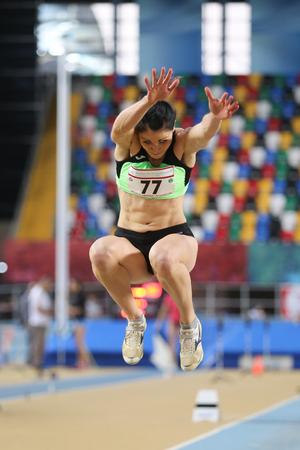 olympic game: ISTANBUL, TURKEY - FEBRUARY 27, 2016: Athlete Sasa Babsek triple jumping in Balkan Athletics Indoor Championships Editorial