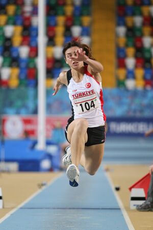 olympic game: ISTANBUL, TURKEY - FEBRUARY 27, 2016: Athlete Tugba Aydin triple jumping in Balkan Athletics Indoor Championships