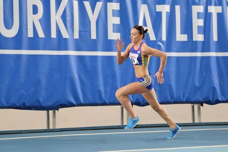olympic game: ISTANBUL, TURKEY - FEBRUARY 27, 2016: Athlete Adelina Pastor running in Balkan Athletics Indoor Championships