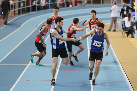 championships: ISTANBUL, TURKEY - FEBRUARY 27, 2016: Athletes running 4x400 metres in Balkan Athletics Indoor Championships