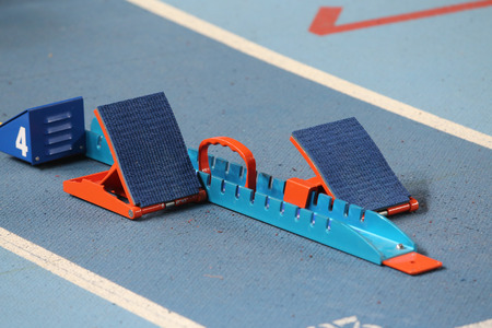 starting blocks: Blue and Orange Starting Blocks in Track and Field