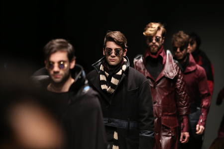 the latest models: ISTANBUL, TURKEY - MARCH 16, 2016: Models showcase the latest creations of Safak Tokur Catwalk in Mercedes-Benz Fashion Week Istanbul