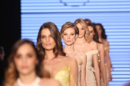couture: ISTANBUL, TURKEY - MARCH 16, 2016: Models showcase the latest creations of Rasit Bagzibagli Couture Catwalk in Mercedes-Benz Fashion Week Istanbul