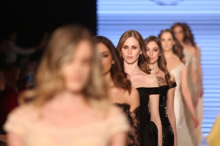 the latest models: ISTANBUL, TURKEY - MARCH 16, 2016: Models showcase the latest creations of Rasit Bagzibagli Couture Catwalk in Mercedes-Benz Fashion Week Istanbul
