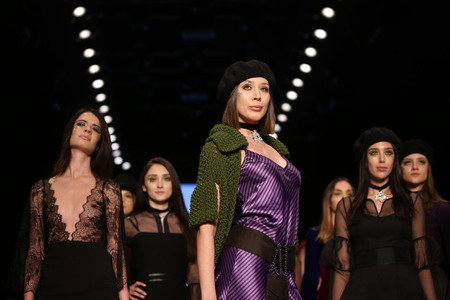 the latest models: ISTANBUL, TURKEY - MARCH 16, 2016: Models showcase the latest creations of Selma State in Mercedes-Benz Fashion Week Istanbul