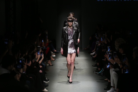 the latest models: ISTANBUL, TURKEY - MARCH 17, 2016: Models showcase the latest creations of Outkastpeople in Mercedes-Benz Fashion Week Istanbul
