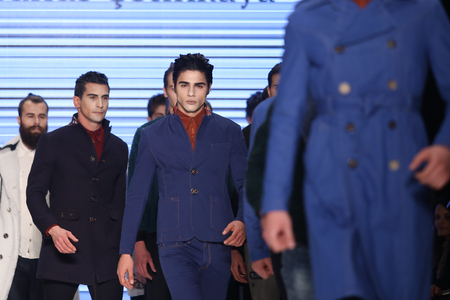 the latest models: ISTANBUL, TURKEY - MARCH 17, 2016: Models showcase the latest creations of Can Yunus Cetinkaya in Mercedes-Benz Fashion Week Istanbul Editorial