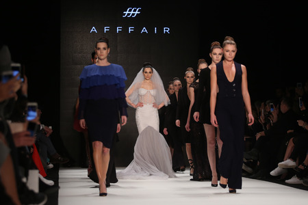 the latest models: ISTANBUL, TURKEY - MARCH 17, 2016: Models showcase the latest creations of Afffair in Mercedes-Benz Fashion Week Istanbul Editorial