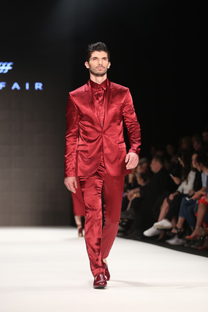 fashion week: ISTANBUL, TURKEY - MARCH 17, 2016: A model showcases one of the latest creations of Afffair in Mercedes-Benz Fashion Week Istanbul Editorial
