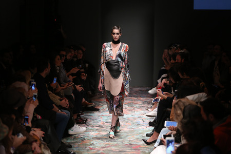 fashion week: ISTANBUL, TURKEY - MARCH 18, 2016: A model showcases one of the latest creations of Bashaques in Mercedes-Benz Fashion Week Istanbul