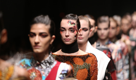 the latest models: ISTANBUL, TURKEY - MARCH 18, 2016: Models showcase the latest creations of Bashaques in Mercedes-Benz Fashion Week Istanbul
