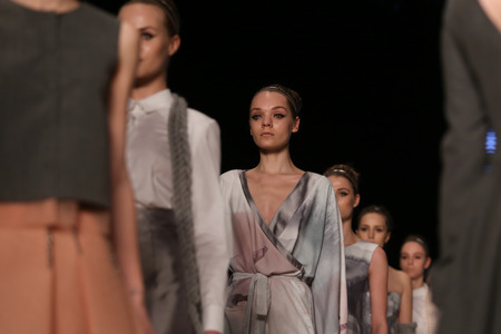 the latest models: ISTANBUL, TURKEY - MARCH 18, 2016: Models showcase the latest creations of Ozlem Erkan in Mercedes-Benz Fashion Week Istanbul Editorial