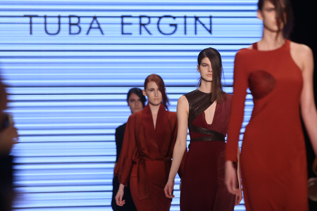 the latest models: ISTANBUL, TURKEY - MARCH 18, 2016: Models showcase the latest creations of Tuba Ergin in Mercedes-Benz Fashion Week Istanbul