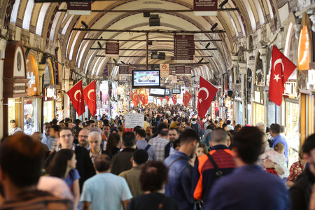 kapalicarsi: ISTANBUL, TURKEY - APRIL 09, 2016: People shopping in the Grand Bazaar. The Grand Bazaar is one of the largest and oldest covered markets in the world.
