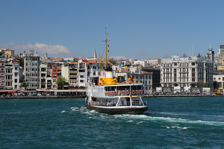 seaway: ISTANBUL, TURKEY - APRIL 30, 2016: Sehir Hatlari ferry passing from Asian side to European side of Istanbul. Sehir Hatlari was established in 1844 and now carry 150,000 passengers a day. Editorial