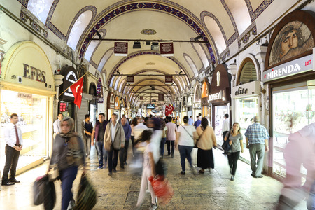 kapalicarsi: ISTANBUL, TURKEY - MAY 14, 2016: People shopping in the Grand Bazaar. The Grand Bazaar is one of the largest and oldest covered markets in the world.