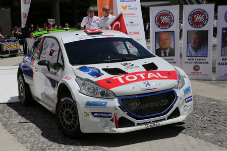 KOCAELI, TURKEY - JUNE 11, 2016: Yagiz Avci with Peugeot 208 T16 R5 of Neomotorspor Team in ceremonial start of Kocaeli Rally