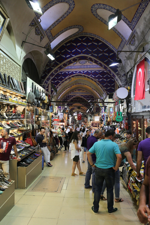 bazar: ISTANBUL, TURKEY - JULY 09, 2016: People shopping in the Grand Bazaar. The Grand Bazaar is one of the largest and oldest covered markets in the world.