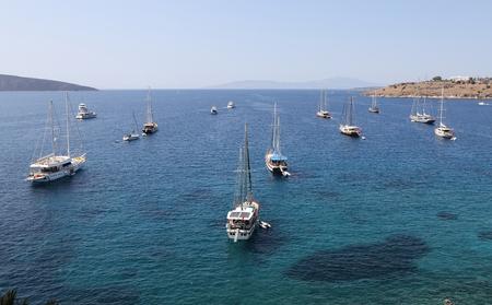 mugla: Sailboats in front of Bodrum Castle in Aegean Turkey