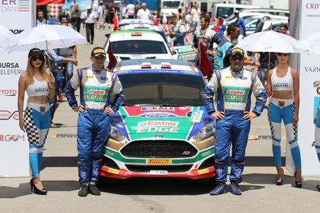 turkiye: BURSA, TURKEY - JULY 23, 2016: Murat Bostanci with Ford Fiesta R5 of Castrol Ford Team Turkiye in ceremonial start of Yesil Bursa Rally