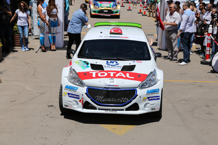 BURSA, TURKEY - JULY 23, 2016: Yagiz Avci with Peugeot 208 T16 R5 of Neomotorspor Team in ceremonial start of Yesil Bursa Rally