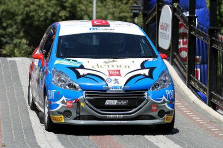 BURSA, TURKEY - JULY 23, 2016: Ahmet Burkay drives Peugeot 208 R2 of BC Vision Motorsport Team in special stage of Yesil Bursa Rally