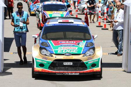 turkiye: BURSA, TURKEY - JULY 23, 2016: Orhan Avcioglu with Ford Fiesta S2000 of Castrol Ford Team Turkiye in ceremonial start of Yesil Bursa Rally
