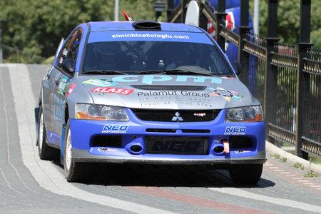 BURSA, TURKEY - JULY 23, 2016: Simin Bicakcioglu drives Mitsubishi Lancer Evo IX of Neo Motorspor Team in special stage of Yesil Bursa Rally