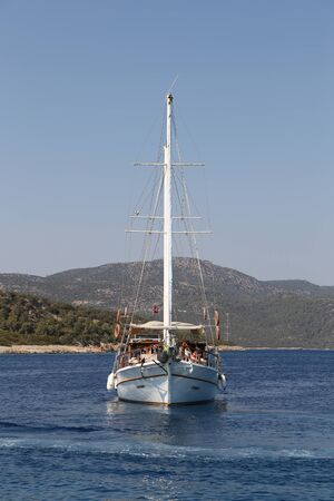 mugla: MUGLA, TURKEY - JULY 22, 2016: People have fun and relaxing in sailboat tour around Bodrum Town,  Aegean sea. Editorial