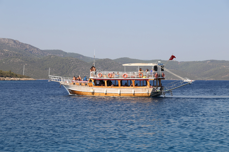 mugla: MUGLA, TURKEY - JULY 22, 2016: People have fun and relaxing in boat tour around Bodrum Town,  Aegean sea.
