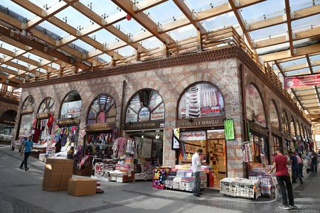 kapalicarsi: BURSA, TURKEY - JULY 23, 2016: Shops in Havlucular bazaar in old Kapalicarsi of Bursa. Kapalicarsi complex was started to be built from 15th century.