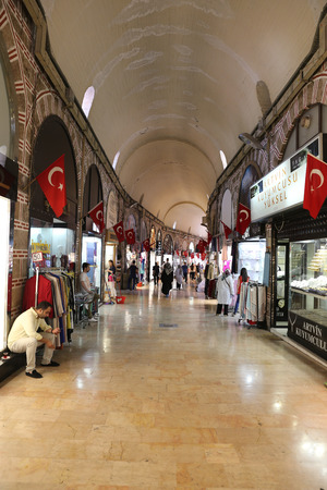 kapalicarsi: BURSA, TURKEY - JULY 23, 2016: Shops in Bakircilar bazaar in old Kapalicarsi of Bursa. Kapalicarsi complex was started to be built from 15th century.