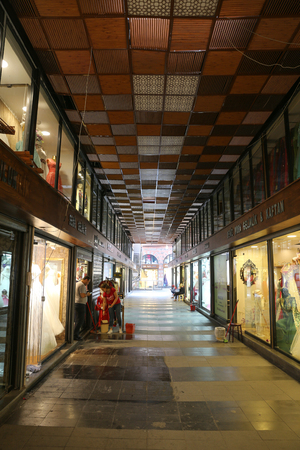 kapalicarsi: BURSA, TURKEY - JULY 23, 2016: Shops in Gelinlikciler bazaar in old Kapalicarsi of Bursa. Kapalicarsi complex was started to be built from 15th century.