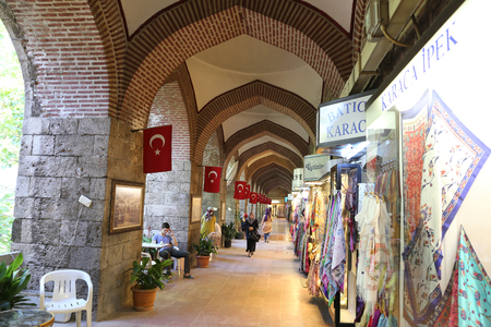 BURSA, TURKEY - JULY 23, 2016: Scarf and silk stores inside of Koza Han. Koza Han was built in 1491 and it is famous with pod and silk sale. Editorial