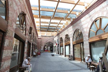 BURSA, TURKEY - JULY 23, 2016: Shops in Havlucular bazaar in old Kapalicarsi of Bursa. Kapalicarsi complex was started to be built from 15th century.